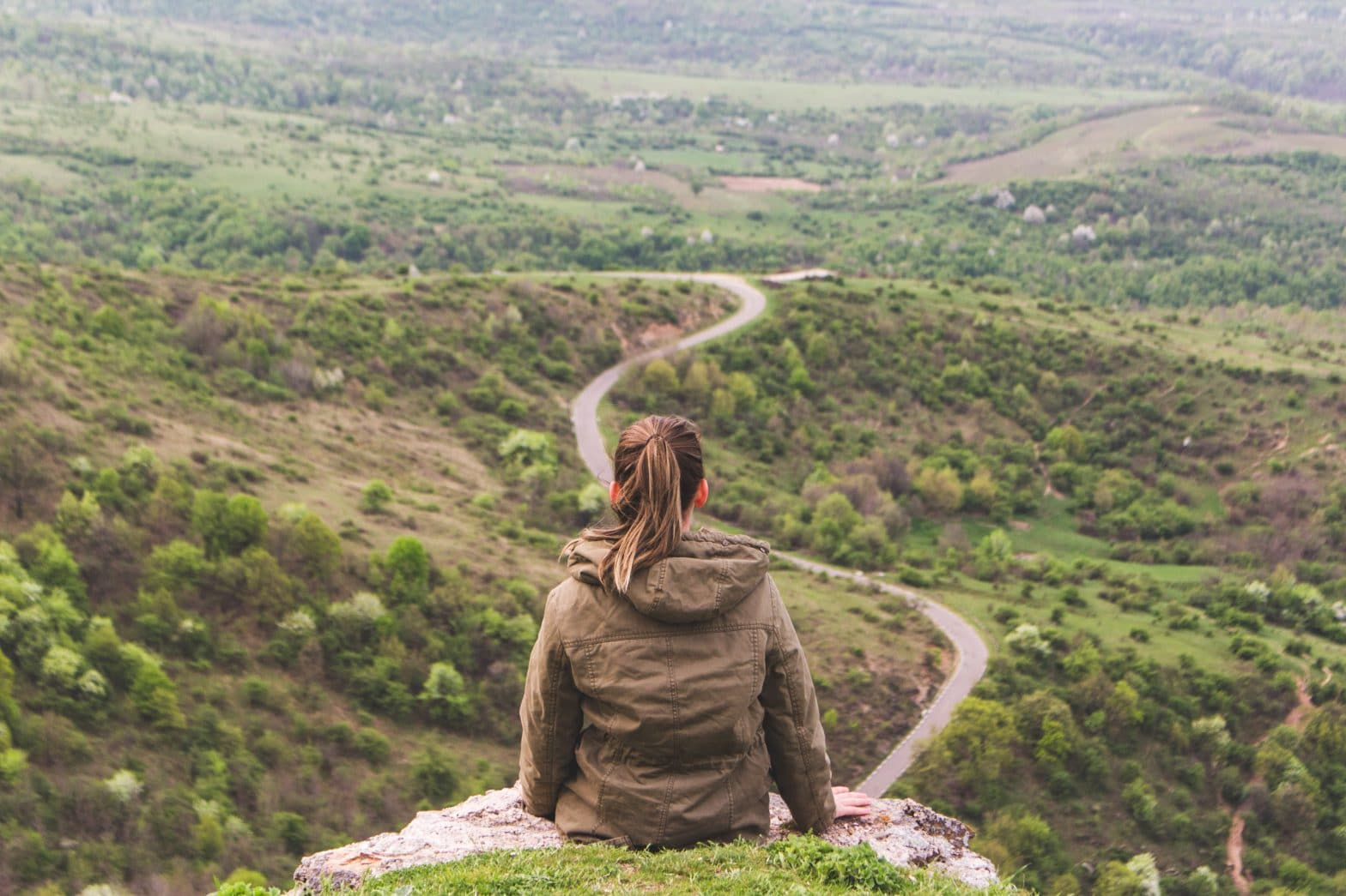 """girl on a hill overlooking winding path -- click to read blog post, """"The Beginning"""""""